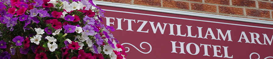 Fitzwilliam Arms Hotel: Picture Of Sign & Flowers